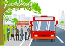 Bus stop with passengers getting on bus Stock Photography