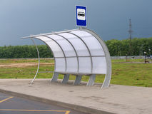 Bus stop with pavilion on asphalt road. Bus stop with pavilion and sign on asphalt road Stock Photography