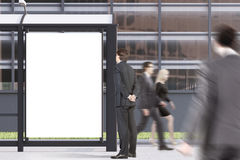 Bus stop poster, people. Business people are passing by a bus stop with a blank vertical poster standing in a street near an office building. 3d rendering, mock Stock Image