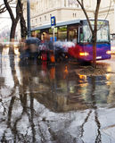 Bus stop in the rain. People getting on the bus in the rain, near Hero´s place, Budapest, Hungary Stock Images