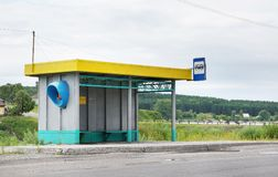 Bus stop on the road in the countryside Royalty Free Stock Images