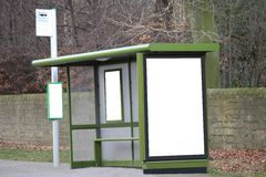 Bus Stop Shelter. A Bus Stop Shelter with Blank Advertising Hoardings royalty free stock photos