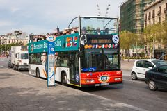 Bus stop and sightseeing bus with tourists in Barcelona, Spain Royalty Free Stock Photography