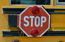 Bus stop sign. A stop sign on a school bus Stock Images