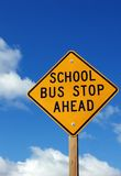Bus Stop Sign. School bus stop ahead sign with a cloudy sky background Stock Photography