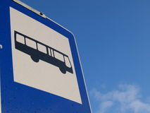 Bus stop sign. Closeup of a bus stop sign against blue sky Stock Image