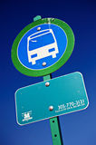 Bus stop sign. A bus stop sign in blue and green royalty free stock image