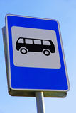 Bus stop sign against of blue sky. Royalty Free Stock Photo
