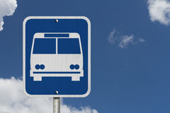 Bus Stop Sign. An American road sign with icon of public bus with blue sky stock photos
