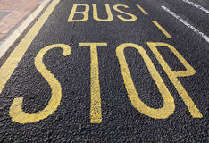 Bus stop sign  on asphalt road Royalty Free Stock Images