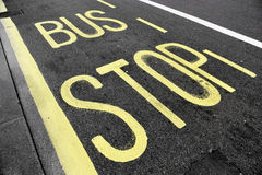 Bus stop sign on asphalt Royalty Free Stock Photo