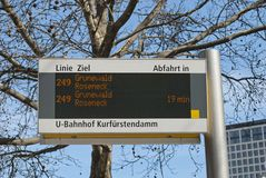 Bus Stop Sign in Berlin. Bus stop sign on blue sky background in Berlin, Germany Royalty Free Stock Photography