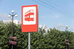 Bus stop sign at roadside royalty free stock photo