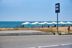 Bus stop with a sign on the sea beach. stock photography