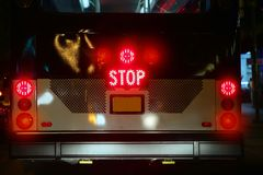 Bus stop signal glowing with traffic lights Royalty Free Stock Image