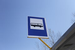 Bus stop traffic sign. Bus stop traffic sign on the roof of busstop Stock Image