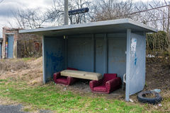 Bus stop in the village with furniture Royalty Free Stock Photography