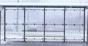 Bus stop in winter with cars. On the background stock video footage