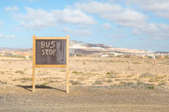 Bus stop wooden board in the desert Stock Image