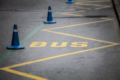 Bus stop. Yellow stripes. Royalty Free Stock Photography
