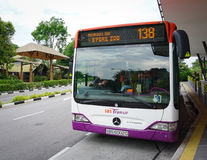 A bus stopping at station in Little India, Singapore Stock Photo