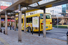 A bus stopping at the station in Tokyo, Japan Royalty Free Stock Images
