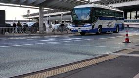 Bus stops at Narita Airport Terminal 1 in the morning. Narita,Japan-December 20, 2017: Many Buses arrive at Narita Airport Terminal1 departure in the winter stock video