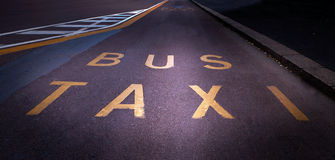 Bus and taxi lane Stock Images