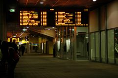 Bus terminal. Dim view of a late evening bus terminal with the screens glowing stock photography