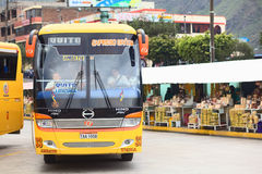 Bus Terminal in Banos, Ecuador. BANOS, ECUADOR - FEBRUARY 22, 2014: Bus of the Expreso Banos transportation company leaving the bus terminal on February 22, 2014 Royalty Free Stock Photography