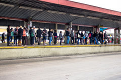Bus Terminal. Porto Alegre, RS, Brazil, October 04, 2016. Bus and passengers inside the Parobe Bus Terminal, next to the Municipal Public Market, in downtown Royalty Free Stock Photos