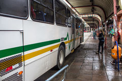 Bus Terminal. Porto Alegre, RS, Brazil, October 04, 2016. Bus and passengers inside the Parobe Bus Terminal, next to the Municipal Public Market, in downtown Royalty Free Stock Image