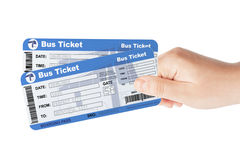 Bus tickets holded by hand Stock Images