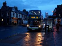 Bus to Dundee. An evening city bus to Dundee takes passengers from a stop in Forfar Royalty Free Stock Photos