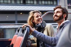 Bus tour of city. Tourist couple on open top bus tour guide around the city in vacation royalty free stock images