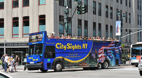 Bus tour driving through manhattan midtown Royalty Free Stock Photo