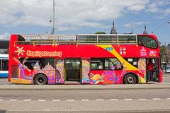 Bus for tourists parked on the Damrak in Amsterdam Royalty Free Stock Photos