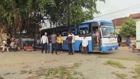 Bus , tourists  , travel , mekong,  cambodia. Southeast asia , Cambodia, Kampong Cham, october 2013.  tourists waiting departure time at bus stock video