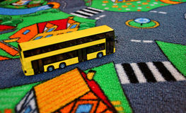 Bus toy on the kids carpet Stock Photos