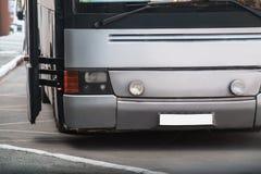 Bus at transport stop Stock Photos