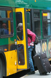 Bus Transportation. People riding public transportation Royalty Free Stock Photos
