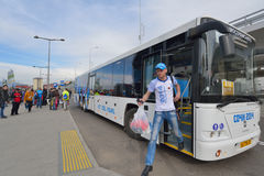 Bus transportation during Sochi Winter Olympics. Sochi, Russia - February 14, 2014: Fan exiting the bus arrived from Sochi to Adler during XXII Winter Olympics Royalty Free Stock Photography