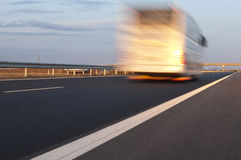 Bus traveling on highway. Stock Image