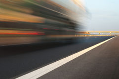 Bus traveling on highway. Motion blur effect Royalty Free Stock Photos