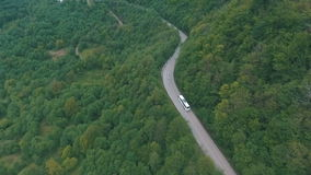A bus traveling on a mountain road,shot from the air. Georgia mountains,winding road in the mountains stock footage