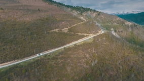 A bus traveling on a mountain road, shot from the air. A bus traveling on a mountain road,shot from the air,Georgia mountains,winding road in the mountains stock video