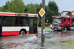 Bus trying to drive against flood on the street in Gdansk, Poland. Royalty Free Stock Photo