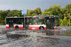 Bus trying to drive against flood on the street in Gdansk, Poland. Stock Photo