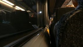 Bus in a Tunnel. Passengers aboard a bus in the Lincoln Tunnel, which connects New York City and New Jersey stock footage