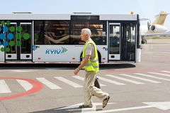 Bus and unidentified airport worker. Igor Sikorsky Kyiv International Airport Zhuliany